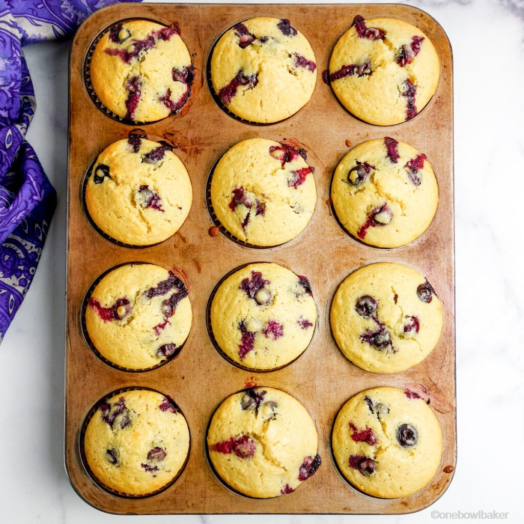 baked blueberry muffins in a burnished muffin tin