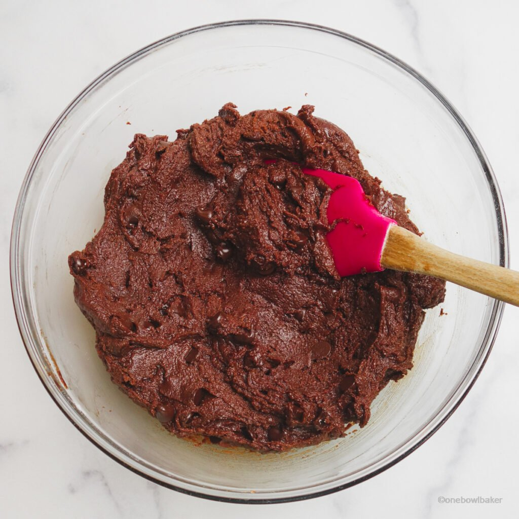 chocolate brownie cookie dough in a glass mixing bowl