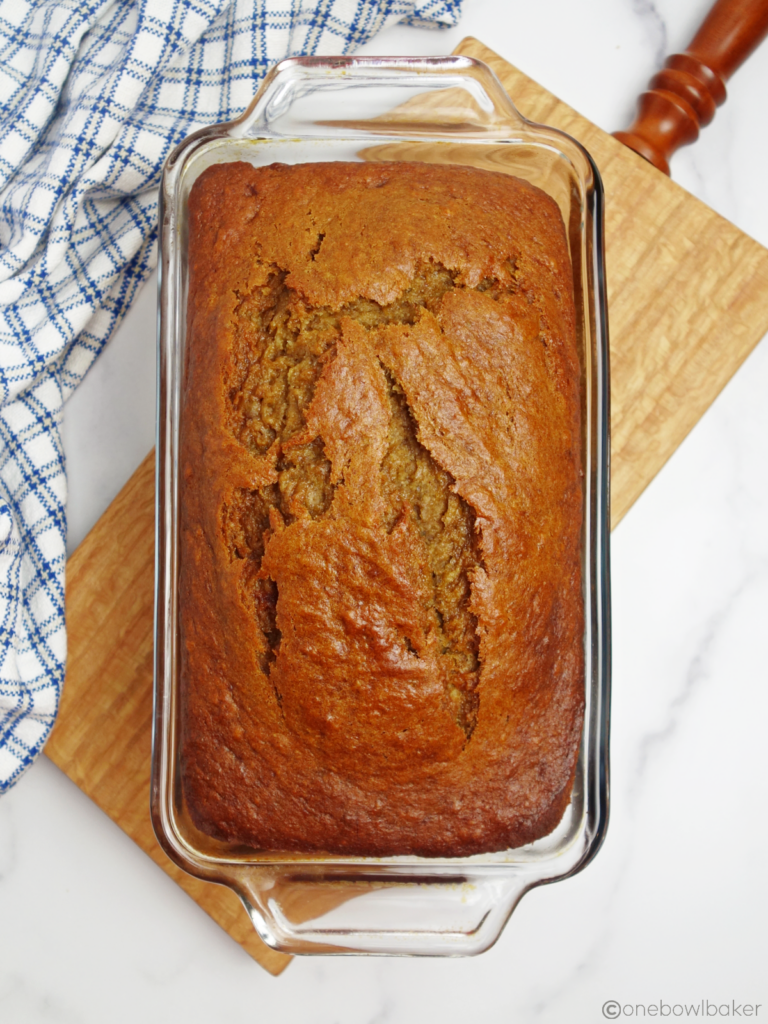 baked banana bread, still in the loaf pan, cooling