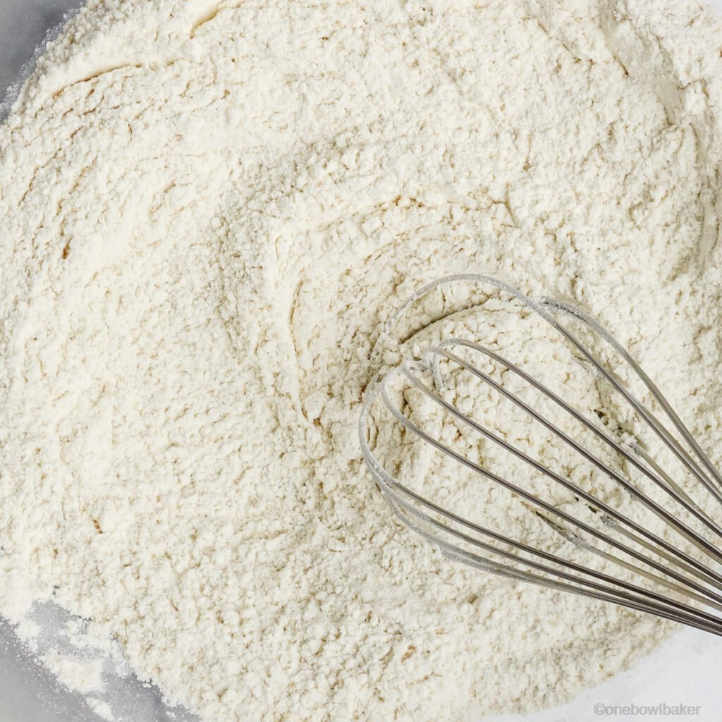 close up of flour in a bowl that has been whisked with baking powder and salt
